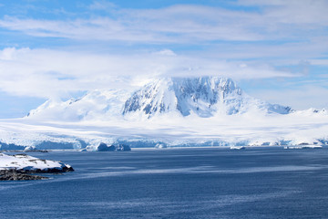 Landscape of snowy mountains and frozen coasts along the Danco Coast in the Antarctic Peninsula, Antarctica