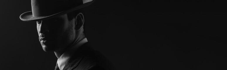 Monochrome image of mafioso with felt hat isolated on black, panoramic shot - fototapety na wymiar