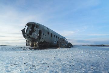 Wreck of Old Plane on Icelandic Black Sand Beach. Amazing Landscape Background.