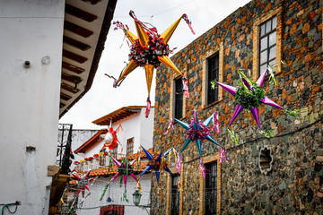 Pinatas as Christmas decorations in the alleys of the historic center of Taxco Mexico.