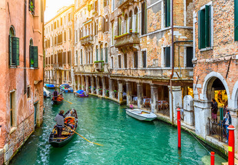 Foto op Canvas Gondolas Narrow canal with gondola in Venice, Italy. Architecture and landmark of Venice. Cozy cityscape of Venice.