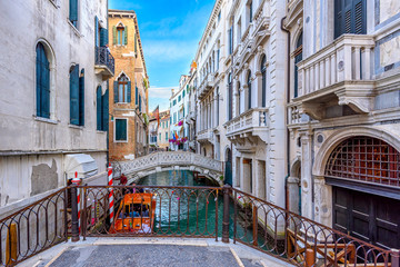 Keuken foto achterwand Venetie Narrow canal with bridge in Venice, Italy. Architecture and landmark of Venice. Cozy cityscape of Venice.