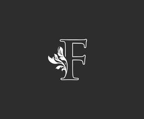 Initial F letter luxury beauty flourishes vintage monogram logo perfect for boutique, wedding invitation, restaurant,hotel.