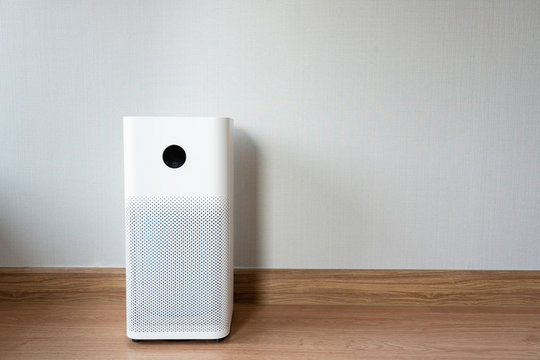 Indoor air purifier with digital monitor screen in bedroom, that show air quality in the room and air pollution levels in the room. PM 2.5 is a major environmental health problem affecting everyone.