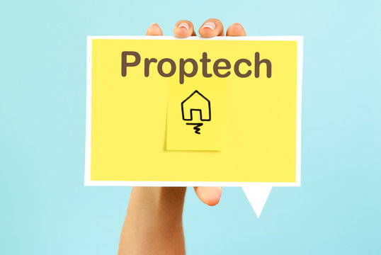 Proptech or Property technology concept. Home symbol on speech bubble with blue background.