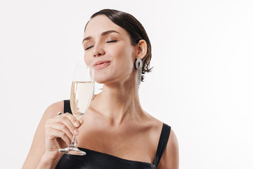 Image of young happy woman smiling and holding glass of champagne
