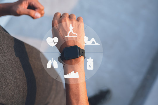Running man with smart watch. Concept of The technology to check health while exercising.