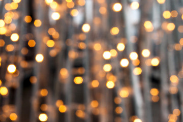 Abstract bokeh background. Golden circles of lights bulb festive garland blurred defocused shine