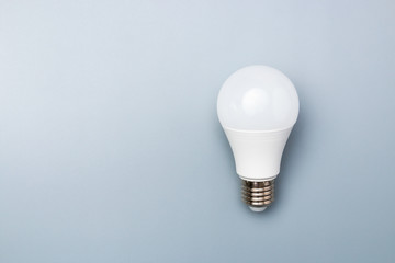 white led bulb on grey background with copy space for advert. business idea concept
