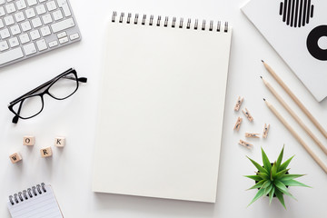 White home office desk. Mockup. Office stuff. Computer, open sketchbook, succulent, glasses,...