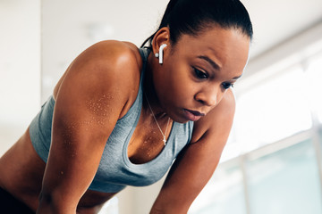 Woman taking a moment to rest in gym