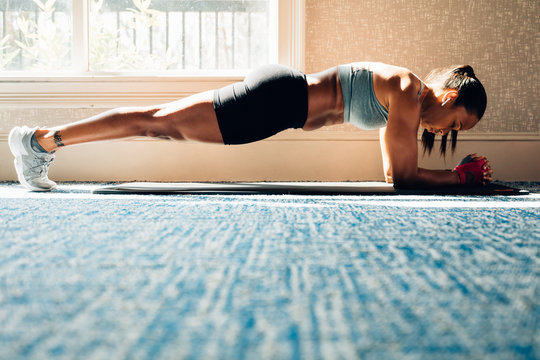 Woman working on core at gym