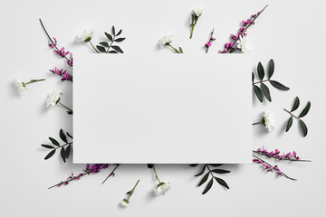 Foto op Textielframe Bloemen Spring minimal concept. Creative flowers flat lay. White paper blank. Top view