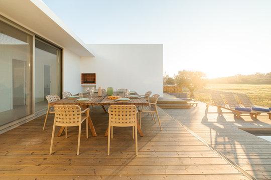 Dinner table setting in modern villa terrace