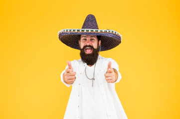 Fest and holiday. Celebrate traditions. hipster looks festive in sombrero. celebrating fiesta. happy man wear poncho. having fun on mexican party. sombrero party man. man in mexican sombrero hat