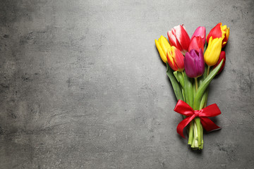 Keuken foto achterwand Tulp Beautiful spring tulips on grey stone table, top view. Space for text