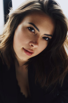 Close up highly detailed shot of attractive fashionable young woman with long loose hair