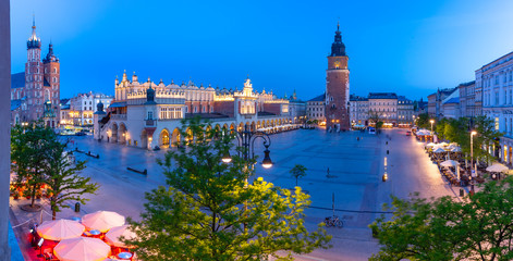 Fototapeten Krakau Aerial panorama of Medieval Main market square with Cloth Hall and Town Hall Tower in Old Town of Krakow at night, Poland