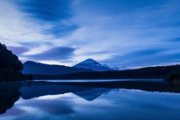 View of Mount Fuji at sunrise on a peaceful morning from lake Saiko, Yamanashi Prefecture, Japan