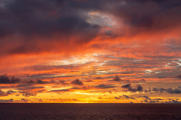 Foto auf Leinwand Kastanienbraun Amazing sunset with colorful clouds and dark ocean water, nature background