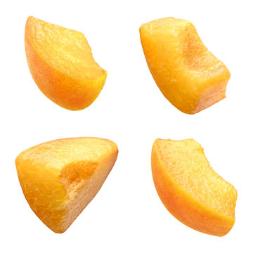 Slices of apricot isolated on white background. Set of tasty ripe sweet pieces of natural organic apricot with juicy pulp