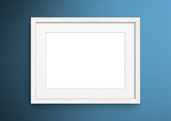 Wall Murals Blue Empty frame. Blank white mounted landscape frame on blue wall