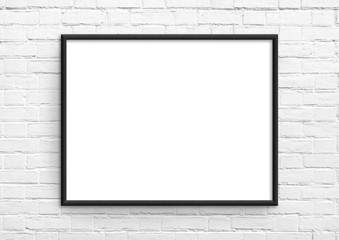 Empty frame. Blank black landscape frame on white brick wall