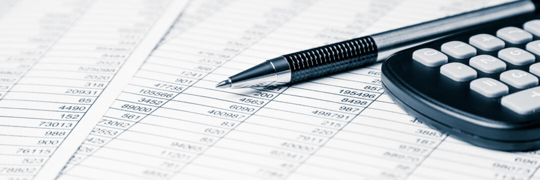 Accounting And Business Concept With Pen And Calculator