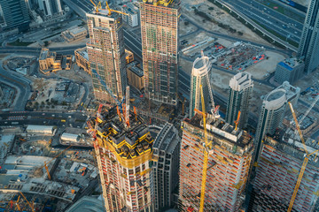Modern construction sites of high rise building in Dubai, view from above. Wall mural