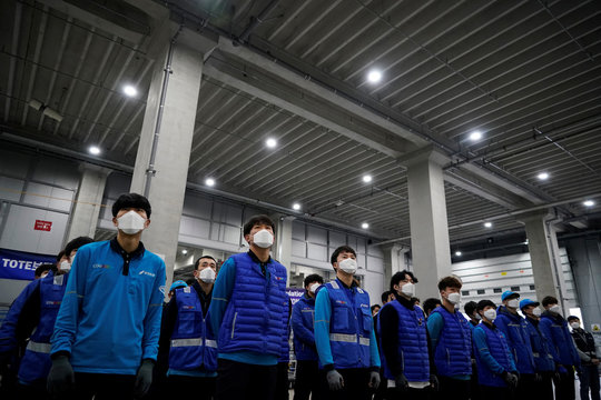 A delivery man for Coupang Jung Im-hong wearing a mask to prevent contracting the coronavirus, gets ready to deliver packages in Incheon