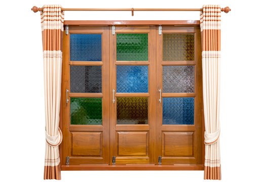 Colorful stained glass window with cream-colored curtains isolated on white background ,include clipping path