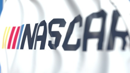 Flying flag with Nascar logo, close-up. Editorial 3D rendering