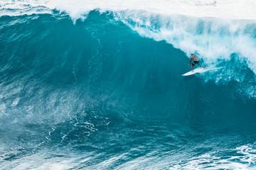 A lone surfer enjoying a big wave in Hawaii.