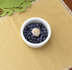 Penaut butter date ball with blueberries on the table