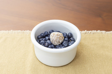 Bowl of blueberries with date ball