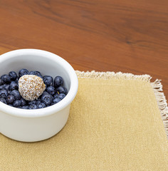 Blueberries and date ball in white bowl