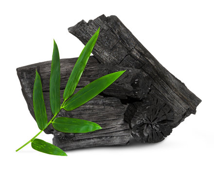 Natural wood charcoal isolated on white background