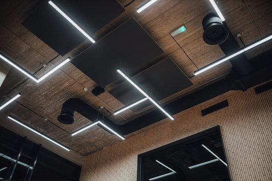 View on modern led lightning hanging from ceilings, industrial building concrete texture