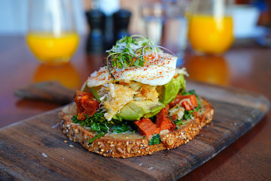 Multigrain avocado toast with fried egg on top