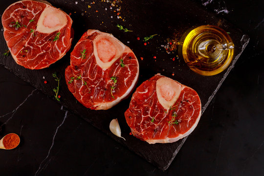 Three pieces of raw fresh beef shank bone in with spices.