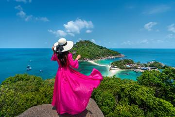 Wall Mural - Beautiful girl standing on viewpoint at Koh Nangyuan island near Koh Tao island, Surat Thani in Thailand.