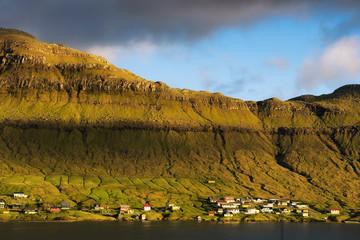 Wall Mural - Coastal village of Signabour in sunset light, Faroe Islands