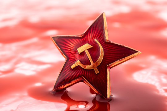 Soviet red star badge in blood