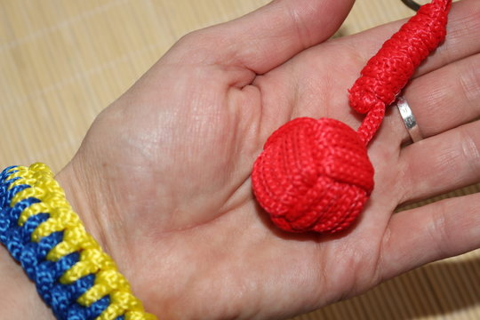 The keychain is made using macrame technique. The main knot is called monkey fist