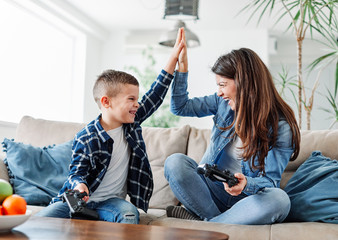 child son mother family happy playing console kid childhood Fototapete