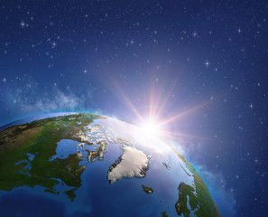 Wall Mural - Sun shining over Arctic, Greenland and Canada from space