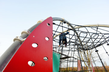 Playground outdoor and a child in action