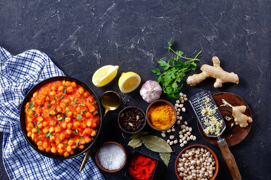 Indian chana masala on a plate with ingredients