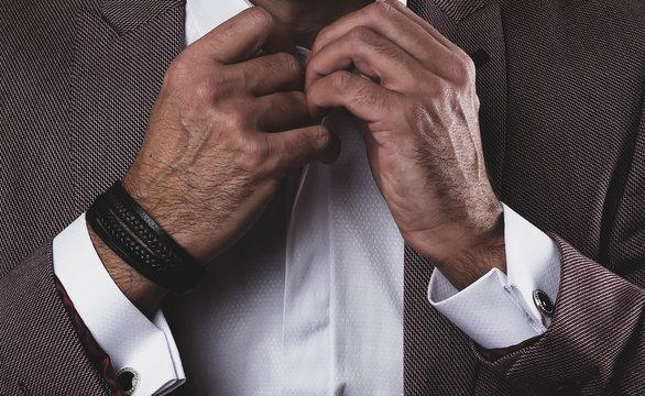 closeup leather bracelet on man's wrist