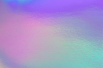 Wall Mural - Abstract trendy rainbow holographic background in 80s style. Blurred texture in violet, pink and mint bright neon colors.